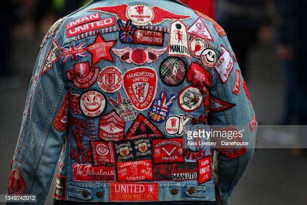 Badges are seen on a supporter of Manchester United prior to the Premier League match between Manchester United and Liverpool at Old Trafford on...