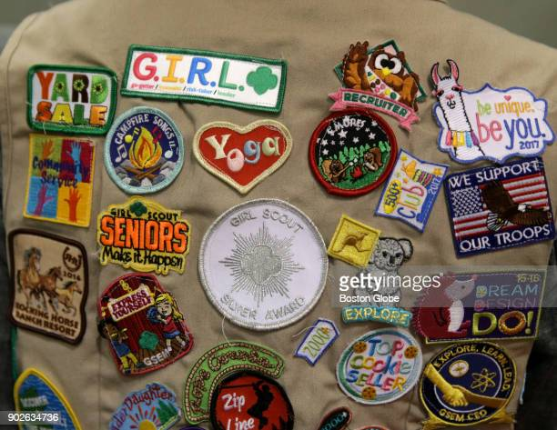 Badges belonging to Medford Girl Scout Marianne O'Connell are pictured as she volunteers for an upcoming charity event at the Boston Convention...