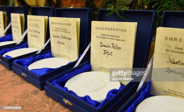 Badges featuring a likeness of Saint Elizabeth have been laid out for the 'Thuringian Rose' award ceremony in Erfurt, Germany, 02 December 2015....