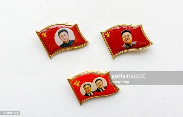 Badges of great leaders of Kim IIsung and Kim Jong II arranged for photography