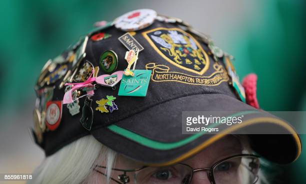 Badges on a Northampton Saints supporters hat during the Aviva Premiership match between Northampton Saints and Harlequins at Franklin's Gardens on...