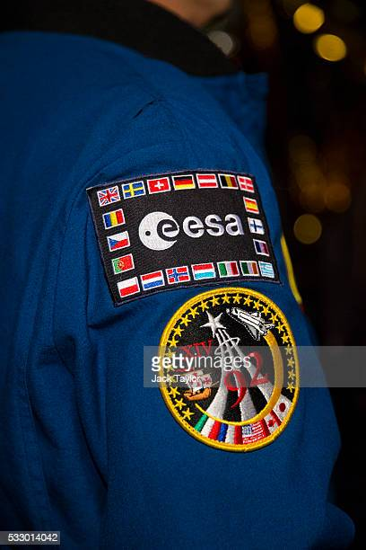Badges on the jacket of European Space Agency astronaut JeanFrancois Clervoy are displayed at an event to mark 25 years since British astronaut Helen...