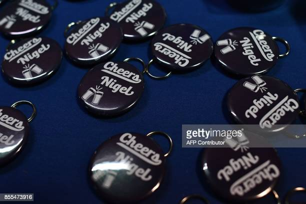 Badges reading 'Cheers Nigel' referring to Former leader of the UK Independence Party Nigel Farage are pictured on the first day of the UK...