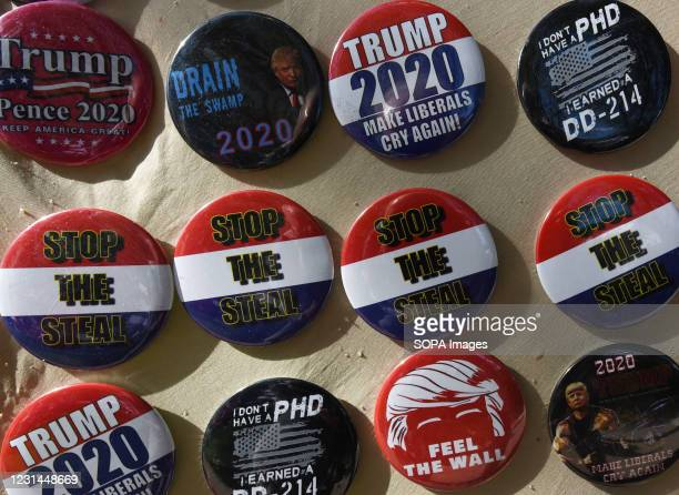 "Badges saying ""Stop the Steal"" are seen for sale outside the 2021 Conservative Political Action Conference at the Hyatt Regency where former..."