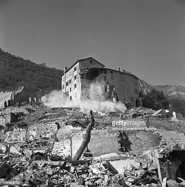 A badly damaged building collapses among the ruins of many more Longarone near the Vajont Dam in the Piave Valley Italy early October 1963 On October...