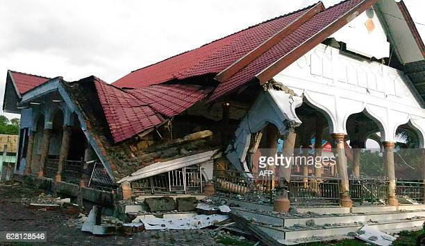 A badly damaged building is seen after a 65magnitude earthquake struck the town of Pidie Indonesia's Aceh province in northern Sumatra on December 7...