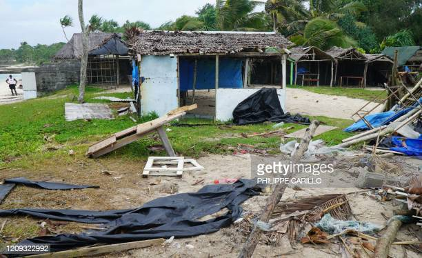 TOPSHOT Badly damaged buildings are pictured near Vanuatu's capital of Port Vila on April 7 after Tropical Cyclone Harold swept past and hit islands...