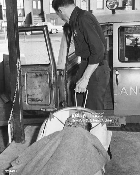 Badly torn by rifle slugs Carmine Persico is being wheeled to Kings County Hospital into ambulance