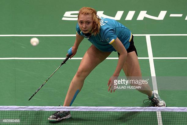Badminton player atalia Perminova of Russia plays a return to opponent Fontaine Mica Chapman of England during their Uber Cup badminton match at Siri...