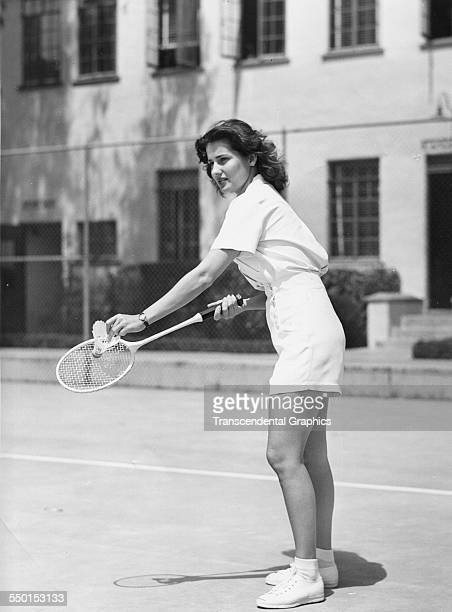 Badminton player is about to serve in a vacation and holiday publicity still photo promoting sunny fun, Florida, circa 1940.