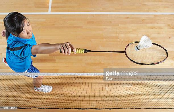 badminton player serving - badminton stock photos and pictures