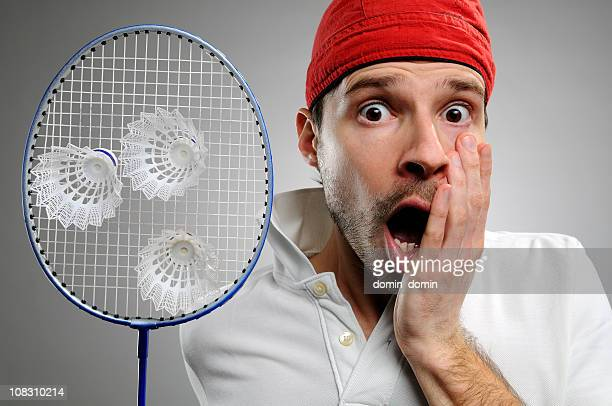 badminton player surprised to see three darts in his rocket - badminton sport stock photos and pictures