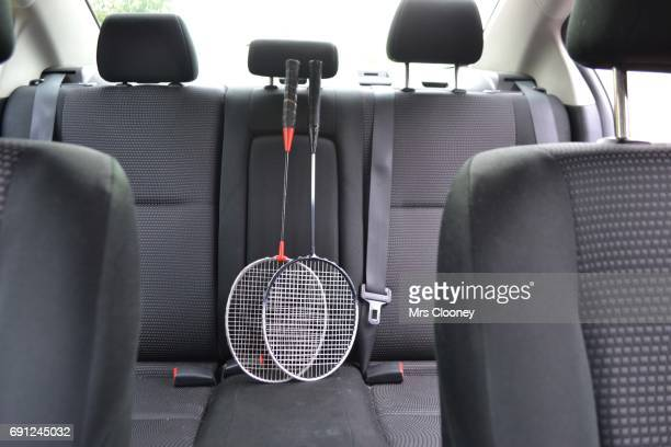 Badminton racquets on the back seat of a family car
