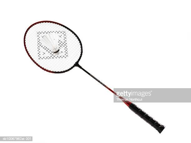 Badminton raquet and birdie on white background