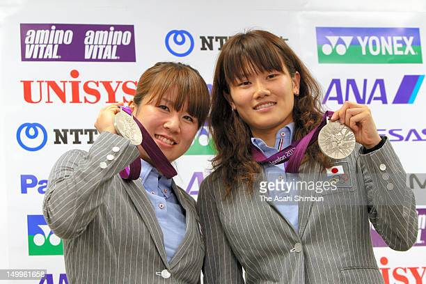 Badminton Women's Doubles silver medalists Mizuki Fujii and Reika Kakiiwa pose for photographs during a press conference on August 7 2012 in Narita...