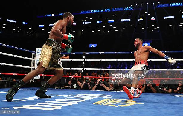 Badou Jack knocks down James DeGale in the twelfth round during their WBC/IBF Super Middleweight Unification bout at the Barclays Center on January...