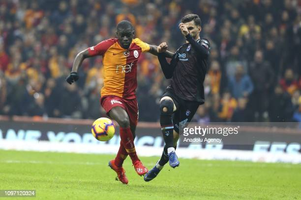 Badou Ndiaye of Galatasaray in action against Huseyin Turkmen of Trabzonspor during Turkish Super Lig soccer match between Galatasaray and...