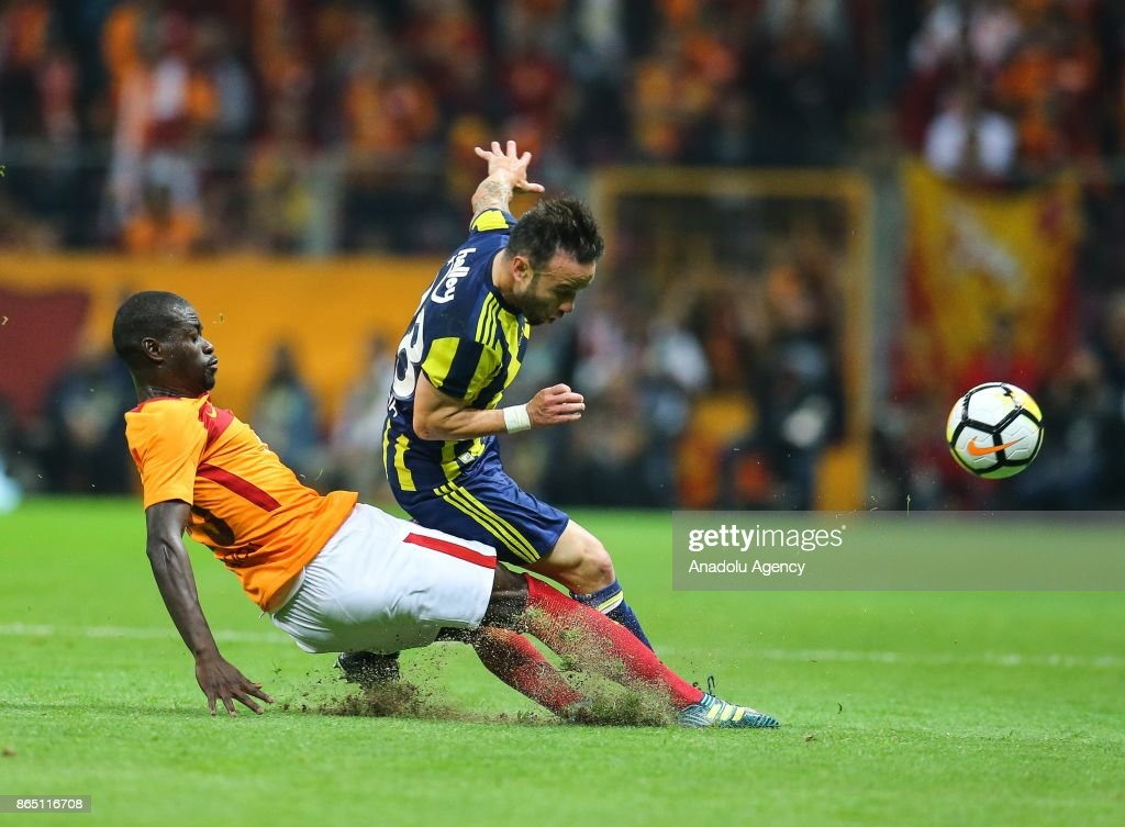 Badou Ndiaye (L) of Galatasaray in action against Mathieu Valbuena (R) of Fenerbahce during the Turkish Super Lig match between Galatasaray and Fenerbahce at Ali Sami Yen Sports Complex - Turk Telekom Stadium in Istanbul, Turkey on October 22, 2017.