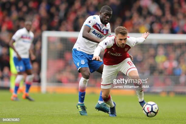 Badou Ndiaye of Stoke City and Aaron Ramsey of Arsenal during the Premier League match between Arsenal and Stoke City at Emirates Stadium on April 1...