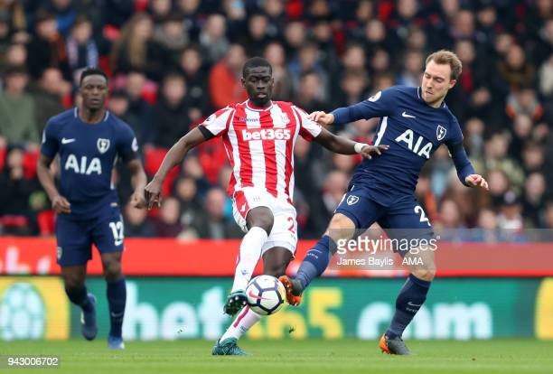 Badou Ndiaye of Stoke City and Christian Eriksen of Tottenham Hotspur during the Premier League match between Stoke City and Tottenham Hotspur at...