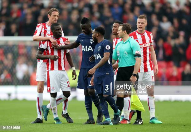 Badou Ndiaye of Stoke City and Danny Rose of Tottenham Hotspur continue to argue after the final whistle during the Premier League match between...