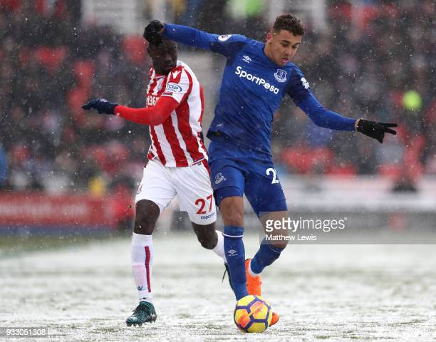 Badou Ndiaye of Stoke City and Dominic CalvertLewin of Everton battle for the ball during the Premier League match between Stoke City and Everton at...