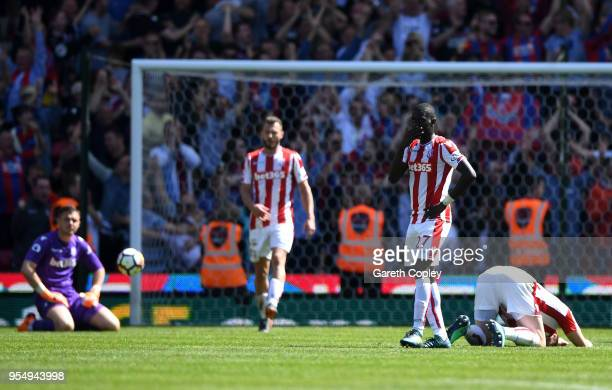Badou Ndiaye of Stoke City and team mates look dejected following Patrick van Aanholt of Crystal Palace scoring his side's second goal during the...