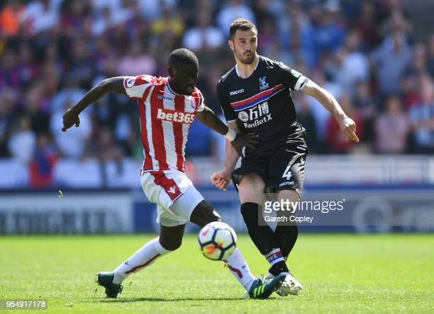 Badou Ndiaye of Stoke City battles for possession with Luka Milivojevic of Crystal Palace during the Premier League match between Stoke City and...