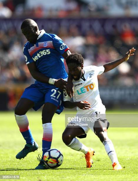 Badou Ndiaye of Stoke City battles for possession with Nathan Dyer of Swansea City during the Premier League match between Swansea City and Stoke...