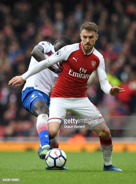 Badou Ndiaye of Stoke City is challenged by Aaron Ramsey of Arsenal during the Premier League match between Arsenal and Stoke City at Emirates...
