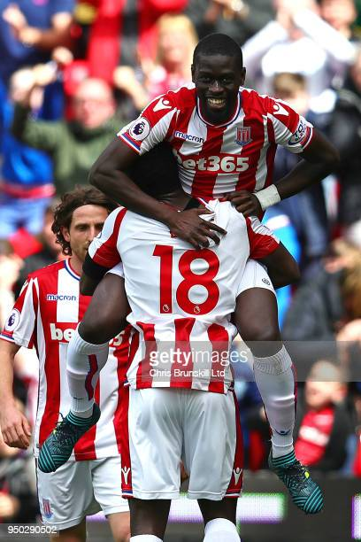 Badou Ndiaye of Stoke City is congratulated by teammate Mame Biram Diouf after scoring the opening goal during the Premier League match between Stoke...