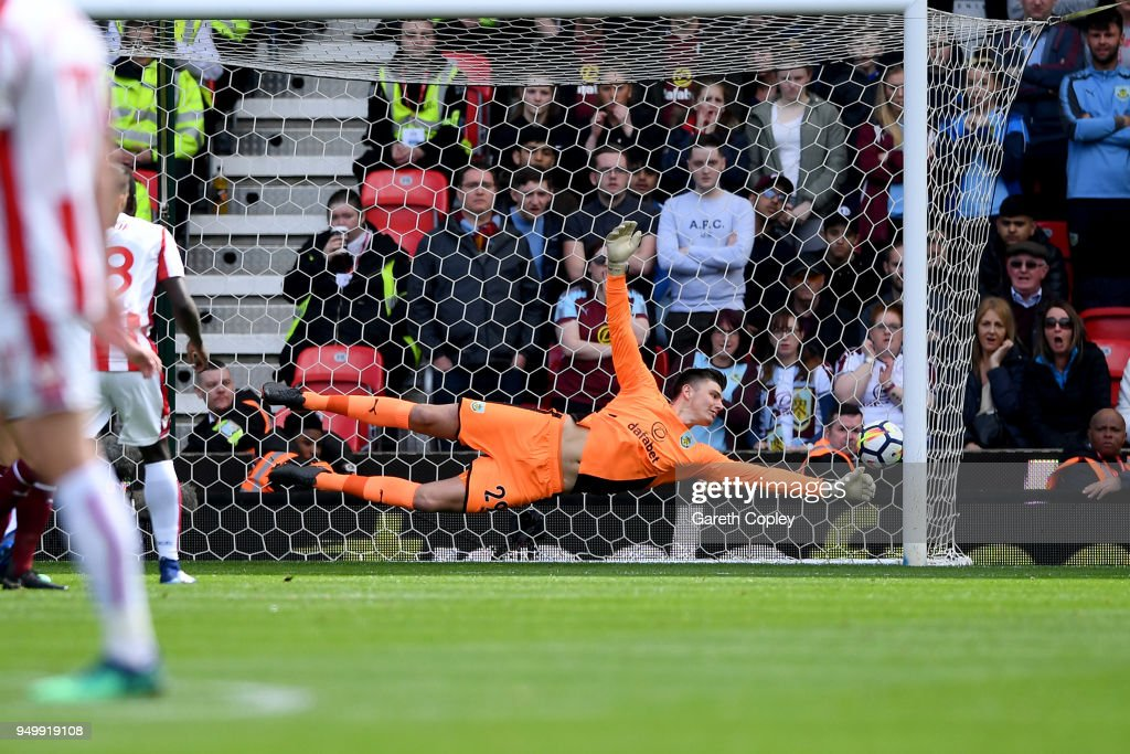 Badou Ndiaye of Stoke City (not pictured) scores his side's first goal past Nick Pope of Burnley during the Premier League match between Stoke City and Burnley at Bet365 Stadium on April 22, 2018 in Stoke on Trent, England.