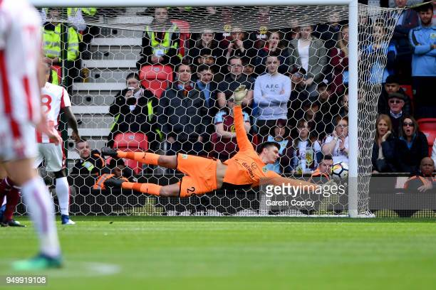 Badou Ndiaye of Stoke City scores his side's first goal past Nick Pope of Burnley during the Premier League match between Stoke City and Burnley at...