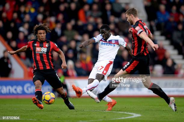 Bojan Krkic of Stoke City shoots under pressure from Nathan Ake of AFC Bournemouth and Simon Francis of AFC Bournemouth during the Premier League...