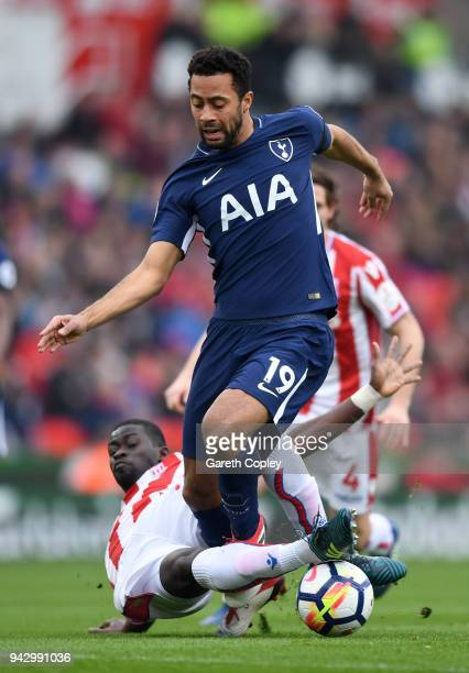 Badou Ndiaye of Stoke City tackles Mousa Dembele of Tottenham Hotspur during the Premier League match between Stoke City and Tottenham Hotspur at...