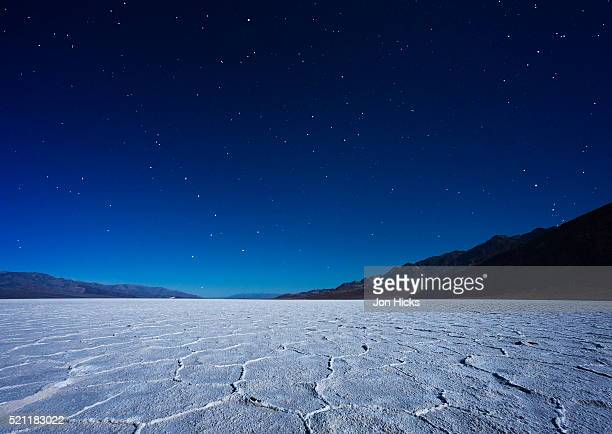 badwater basin by moonlight. - salt flat stock pictures, royalty-free photos & images