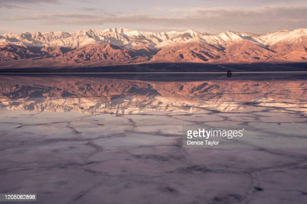 badwater basin sunrise with rare reflections - death valley national park stock pictures, royalty-free photos & images