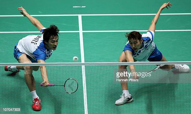 Baekcheol Shin and Hyojung Lee of South Korea on their way to winning gold in the Mixed Doubles Final Match against Nan Zhang and Yunlei Zhao at...