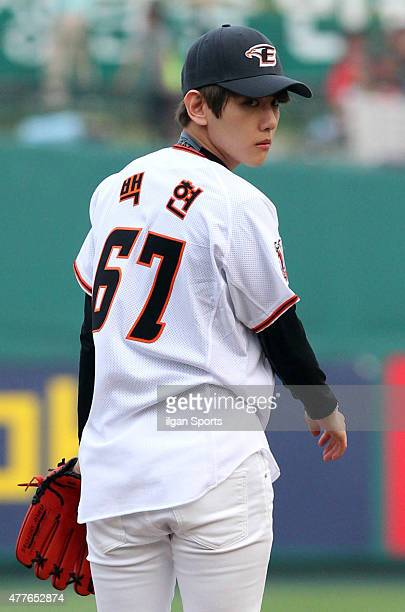 Baekhyun of EXO throws out the ceremonial first pitch before the game between Hanwha Eagles VS SK Wyverns at Eagles Park on June 16 2015 in Daejeon...