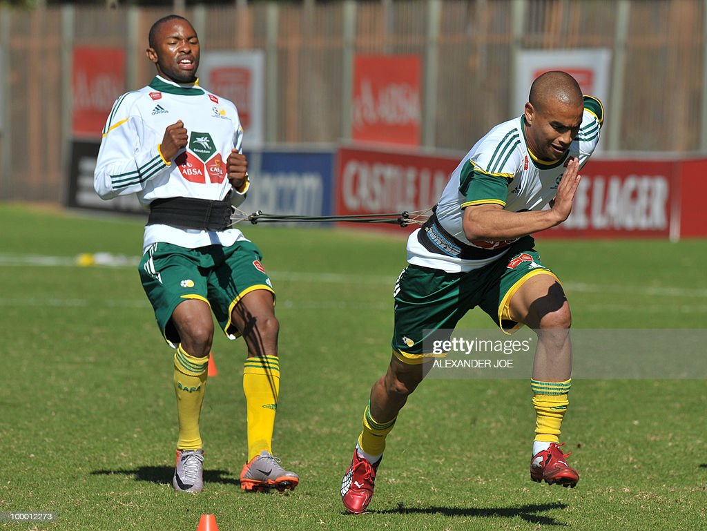 Bafana Bafana (The Boys, nickname of the South African national football team) Bryce Moon (R) tries to pull back an unidentified team mate during a training session in Johannesburg on May 20, 2010. South Africa occupy Group A with former winners France as well as Uruguay and Mexico, all top-20 national teams in the latest rankings from world rulers FIFA.