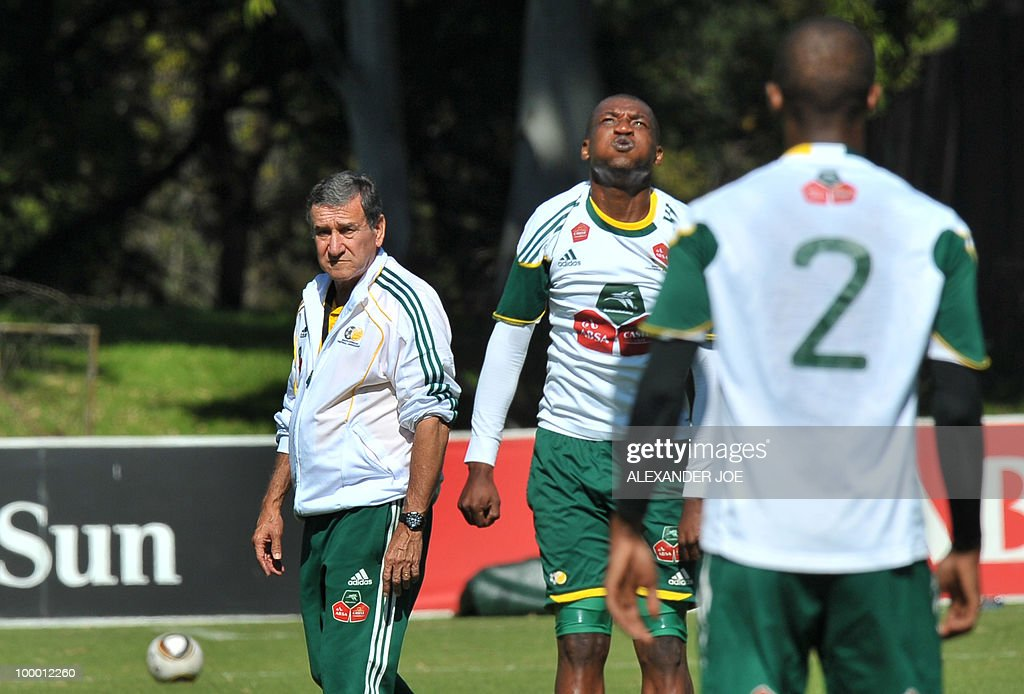 Bafana Bafana (The Boys, nickname of the South African national football team) coach Carlos Alberto Parreira from Brazil (L) keeps an eye on players during a training session in Johannesburg on May 20, 2010. South Africa occupy Group A with former winners France as well as Uruguay and Mexico, all top-20 national teams in the latest rankings from world rulers FIFA.