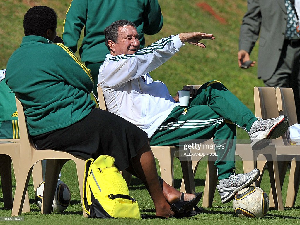 Bafana Bafana (The Boys, nickname of the South African national football team) coach Carlos Alberto Parreira from Brazil (R) talks with a training team member during a training session in Johannesburg on May 20, 2010. South Africa occupy Group A with former winners France as well as Uruguay and Mexico, all top-20 national teams in the latest rankings from world rulers FIFA.
