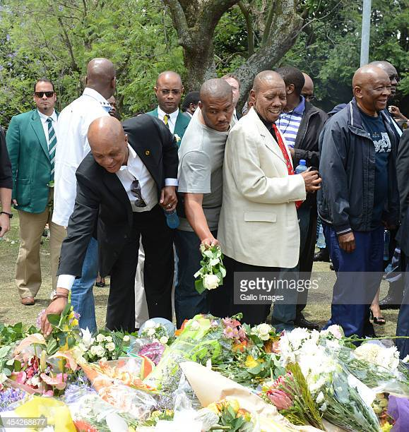 Bafana Bafana legend Doctor Khumalo and Chan CEO Mvuzo Mbebe The thousands of tributes to Former President Nelson on December 7 2013 in Johannesburg...