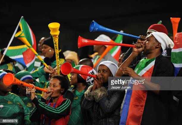 Bafana Bafana supporters blow their vuvuzelas prior to the FIFA Confederations Cup match between Spain and South Africa at Free State Stadium on June...