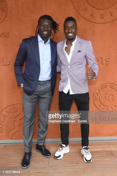 Bafe Gomis and Blaise Matuidi attend the 2019 French Tennis Open - Day Three at Roland Garros on May 28, 2019 in Paris, France.