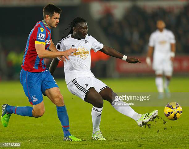 Bafetibis Gomis of Swansea City holds off Scott Dann of Crystal Palace during the Barclays Premier League match between Swansea City and Crystal...