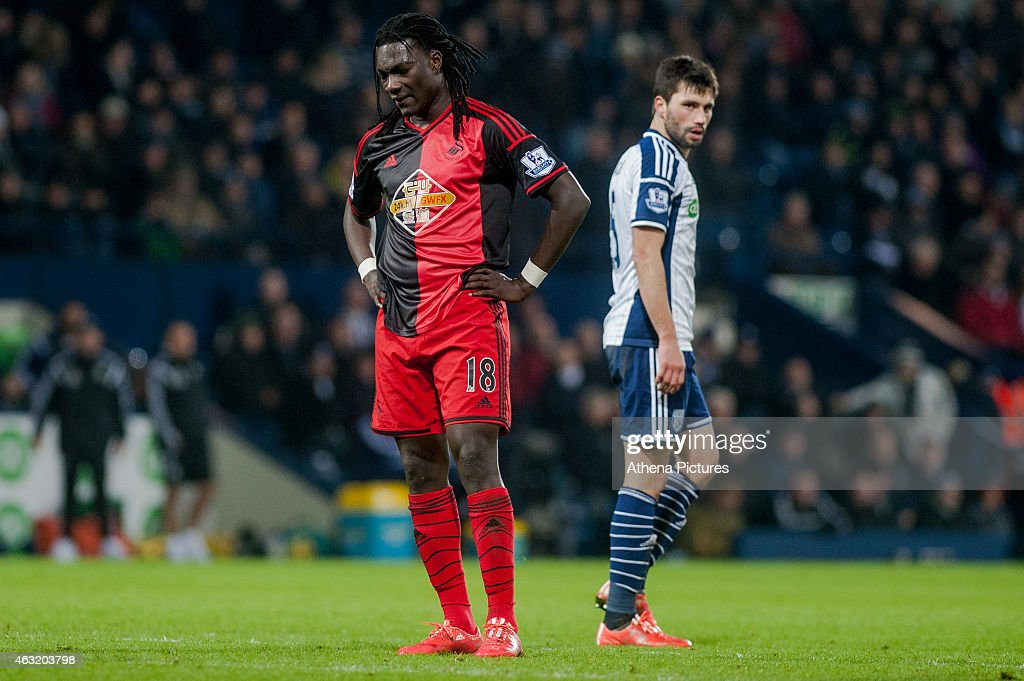Bafetibis Gomis of Swansea City looks to the floor after missing a shot on goal during the Premier League match between West Bromwich Albion and Swansea City at The Hawthorns on February 11, 2015 in West Bromwich, England.