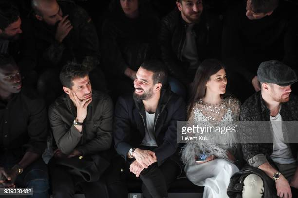 Bafetimbi Gomis Emre Belezoglu Arda Turan guest and Ogulcan Engin attend the St Nian show during Mercedes Benz Fashion Week Istanbul at Zorlu...