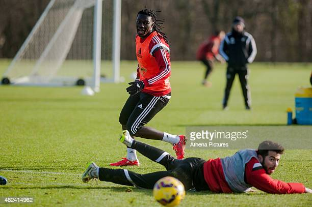 Bafetimbi Gomis looks on as Jordi Amat of Swansea City if floored during training on January 28 2015 in Swansea Wales