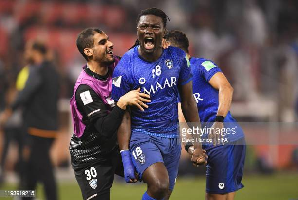 Bafetimbi Gomis of Al Hilal SFC celebrates with team mate Mohammed Alwakid of Al Hilal SFC after scoring his team's first goal during the FIFA Club...